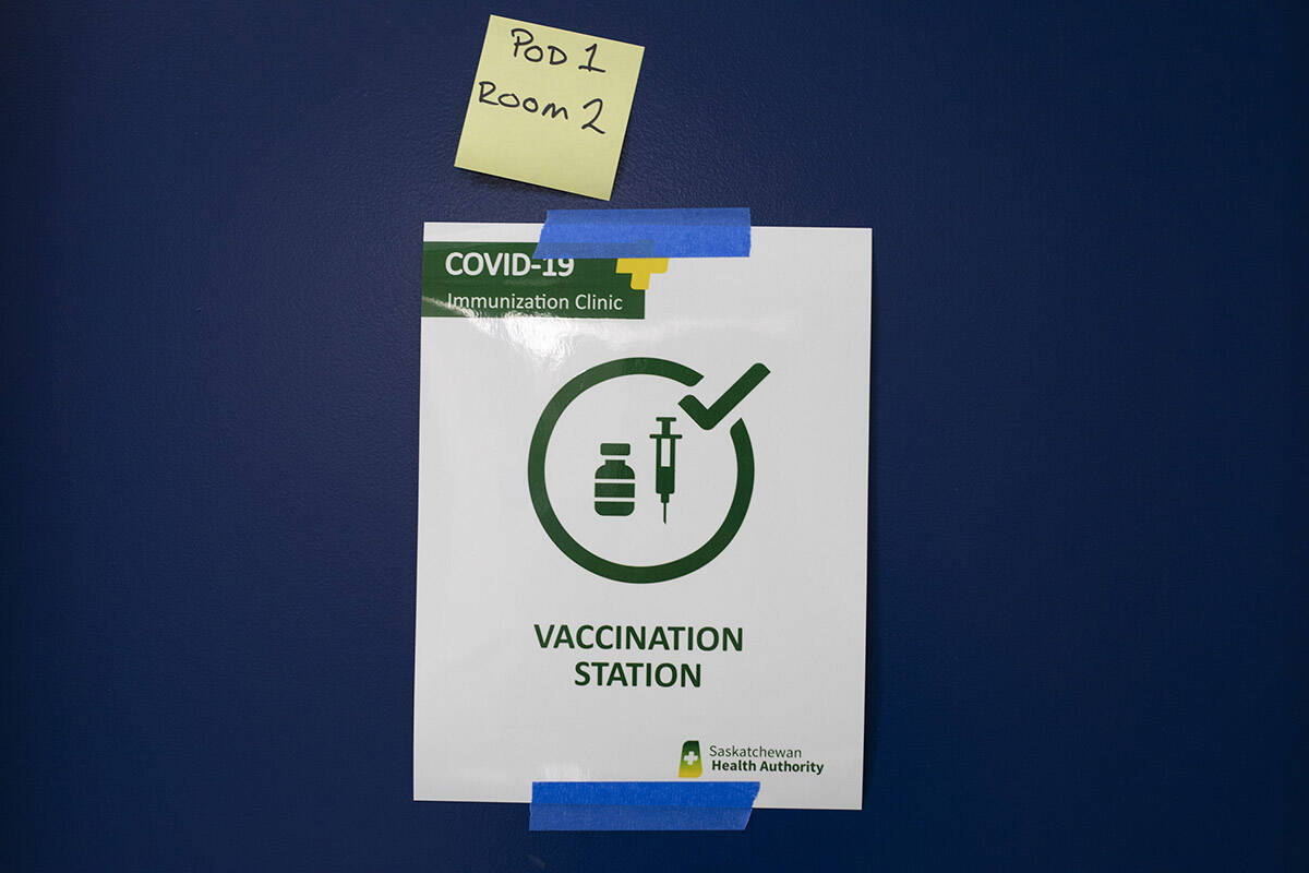 A Saskatchewan Health Authority sign signifying a vaccine station at the Saskatoon Tribal Council run vaccination clinic inside SaskTel centre in Saskatoon, Sask., on Thursday, April 15, 2021. THE CANADIAN PRESS/Kayle Neis