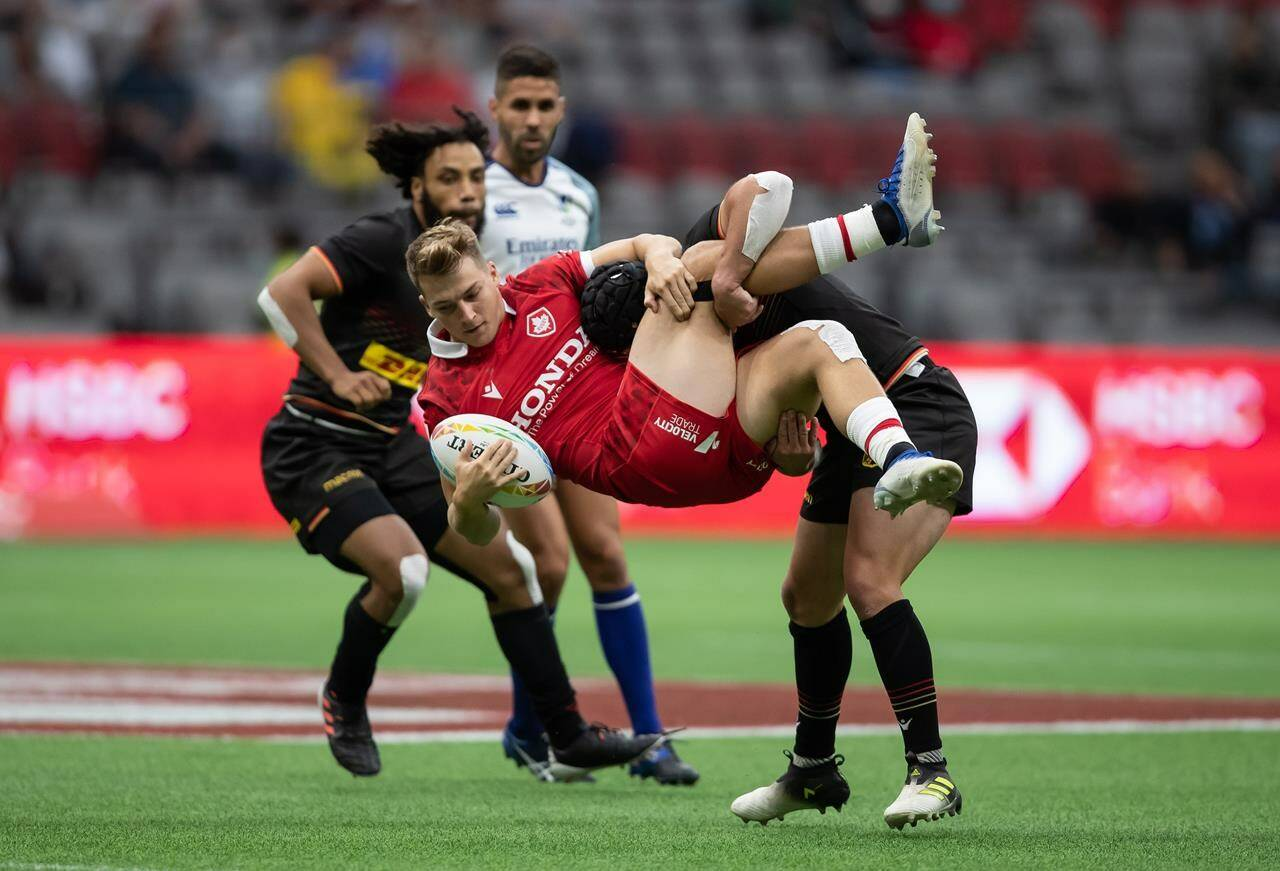 Canada's Ciaran Breen, front, is tackled by Germany's John Dawe during HSBC Canada Sevens rugby action, in Vancouver, B.C., Saturday, Sept. 18, 2021. THE CANADIAN PRESS/Darryl Dyck