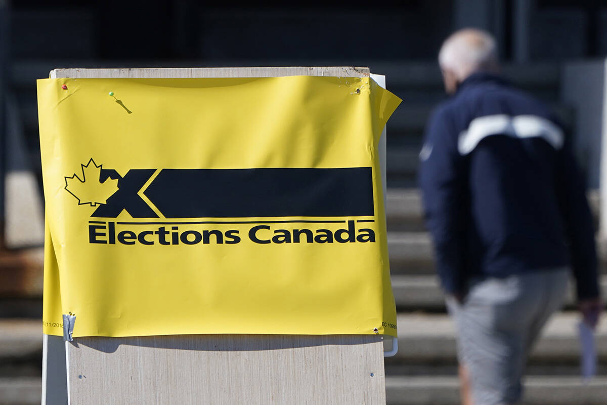 A man enters an advance polling station in Ottawa, Friday, Sept. 10, 2021. Advance polls opened today ahead of the Federal Election Sept. 20th. THE CANADIAN PRESS/Adrian Wyld