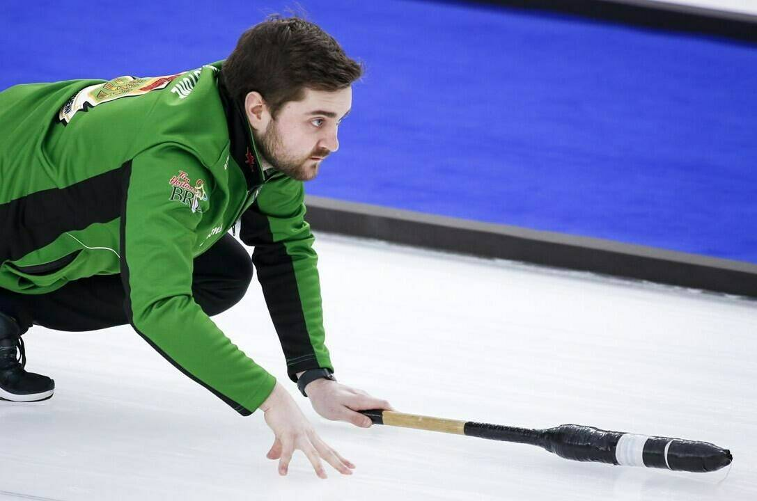 Team Saskatchewan skip Matt Dunstone directs his teammates as he plays Team Northern Ontario at the Brier in Calgary, Alta., on March 13, 2021. THE CANADIAN PRESS/Jeff McIntosh