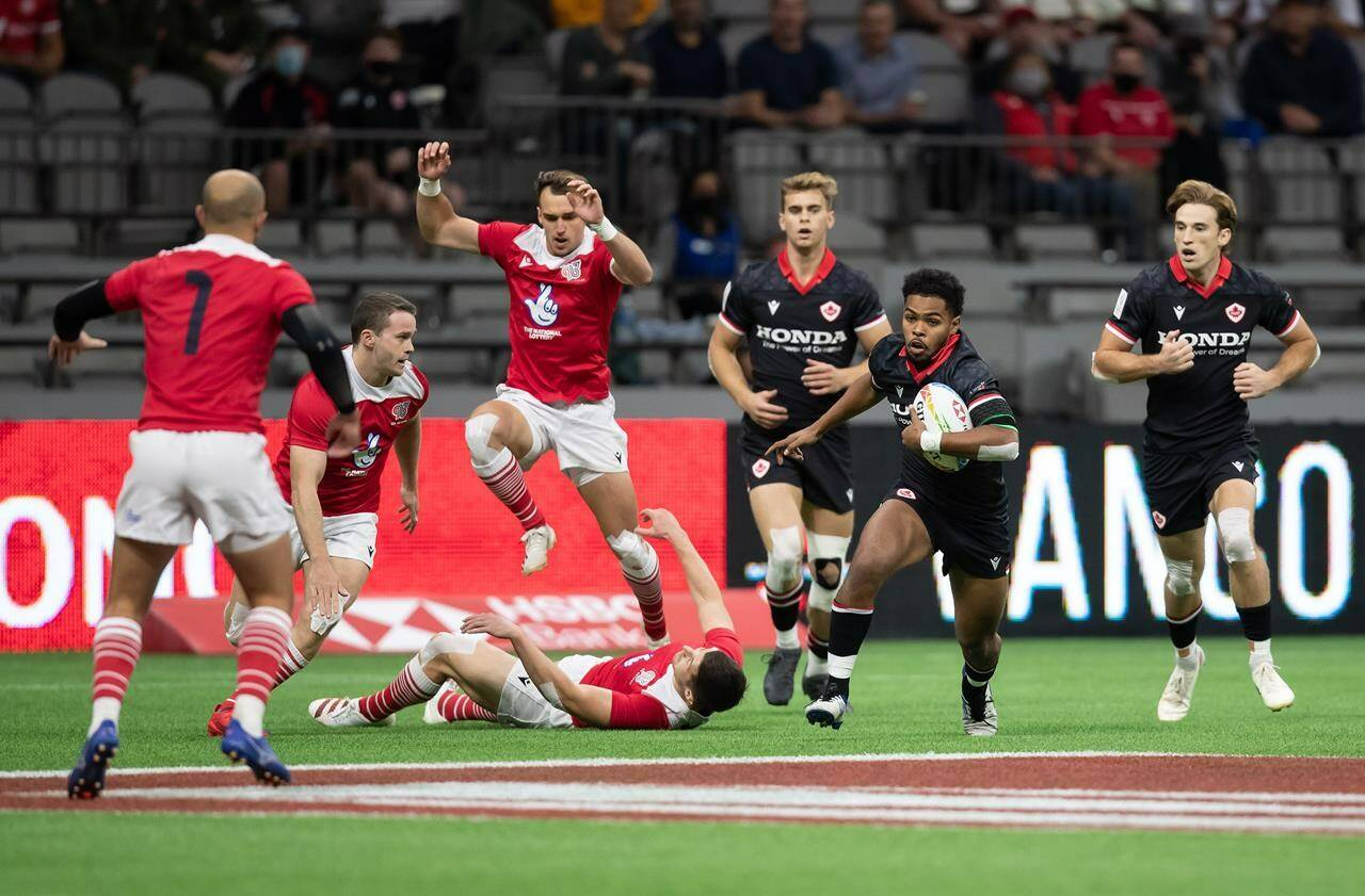 Canada's Josiah Morra, second right, runs with the ball during HSBC Canada Sevens quarterfinal rugby action against Britain, in Vancouver, on Sunday, September 19, 2021. THE CANADIAN PRESS/Darryl Dyck