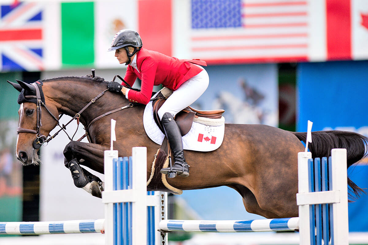Tiffany Foster and Northern Light clear a jump during the $600,000 BMO Nations Cup at The 2021 Spruce Meadows Masters Tournament. (Kim Gaudry/special to Langley Advance Times)
