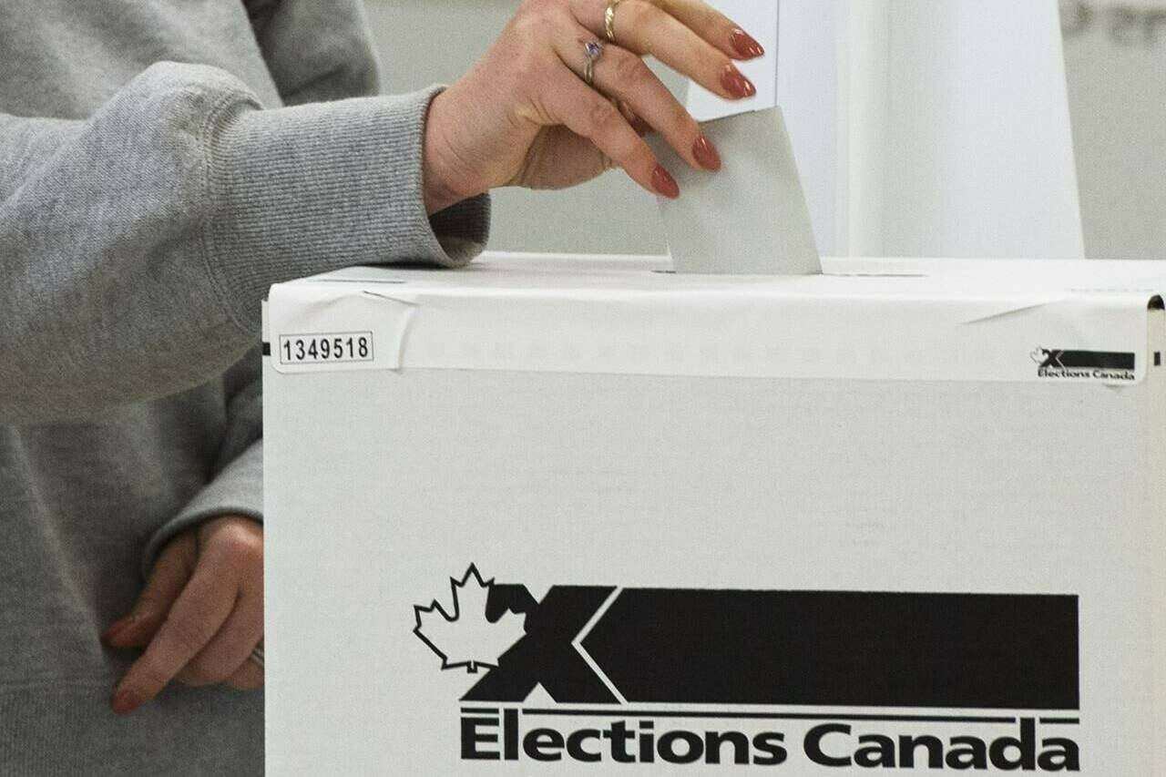A voter casts their ballot in the advance polls, in Chambly, Que., Friday, Sept. 10, 2021. Canada's first-ever pandemic election culminates today as Canadians from coast-to-coast go to the polls to choose the 338 MPs to sit in the House of Commons. THE CANADIAN PRESS/Ryan Remiorz