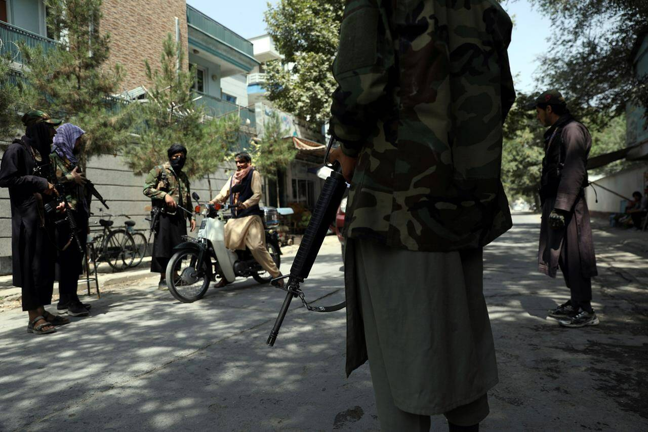 Taliban fighters stand guard at a checkpoint in the Wazir Akbar Khan neighborhood in the city of Kabul, Afghanistan, Aug. 22, 2021. Dozens of female Afghan students have escaped the Taliban and are heading to Saskatoon after a daring land journey lasting weeks. THE CANADIAN PRESS/AP-Rahmat Gul