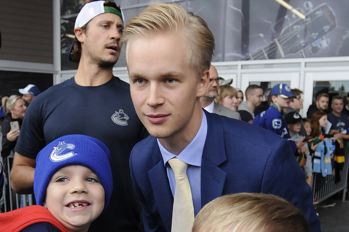 Elias Pettersson greets young fans outside Abbotsford Centre in 2019. The Canucks forward is not yet signed, so it's unclear if he will return to Abbotsford for training camp or a preseason game later this week. (John Morrow/Abbotsford News)