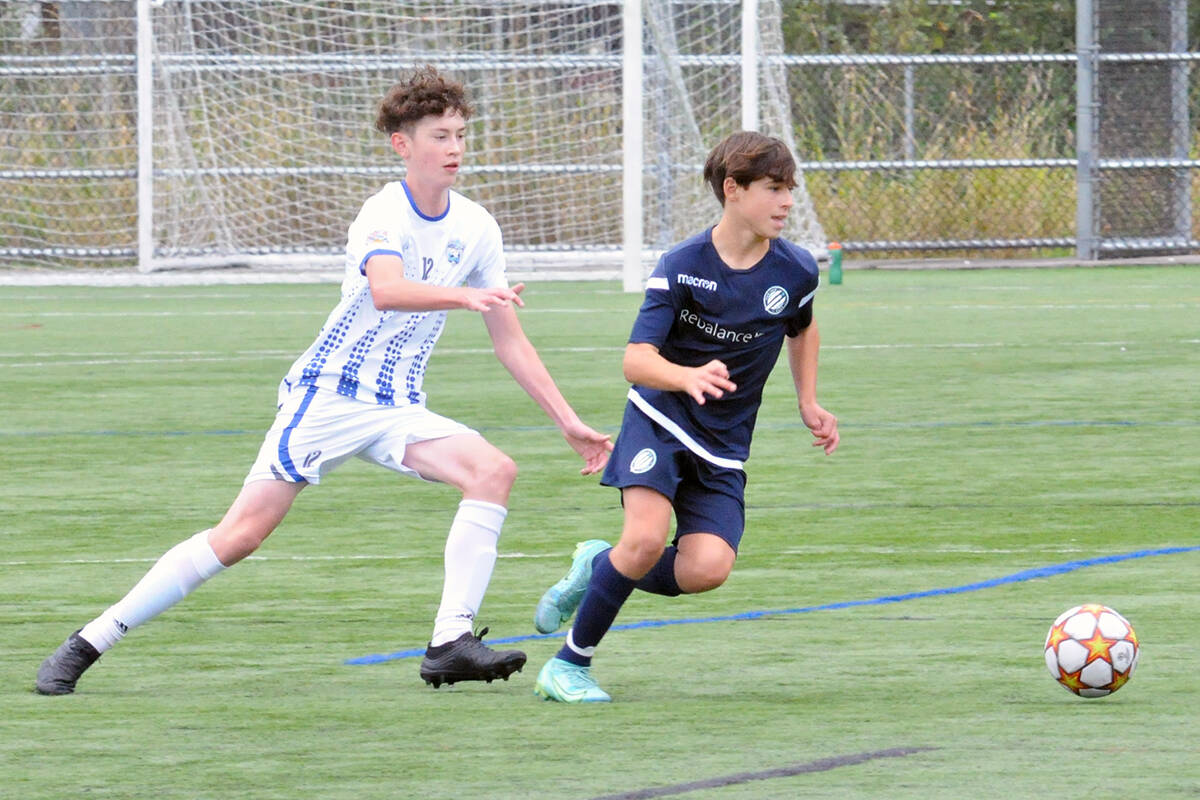 Langley United player Oliver Amos pursued a Vancouver Island Wave opponent on Sunday, Sept. 19 in the first BC Soccer Premier League games since the return to play was shut down due to Covid 19. (Dan Ferguson/Langley Advance Times)