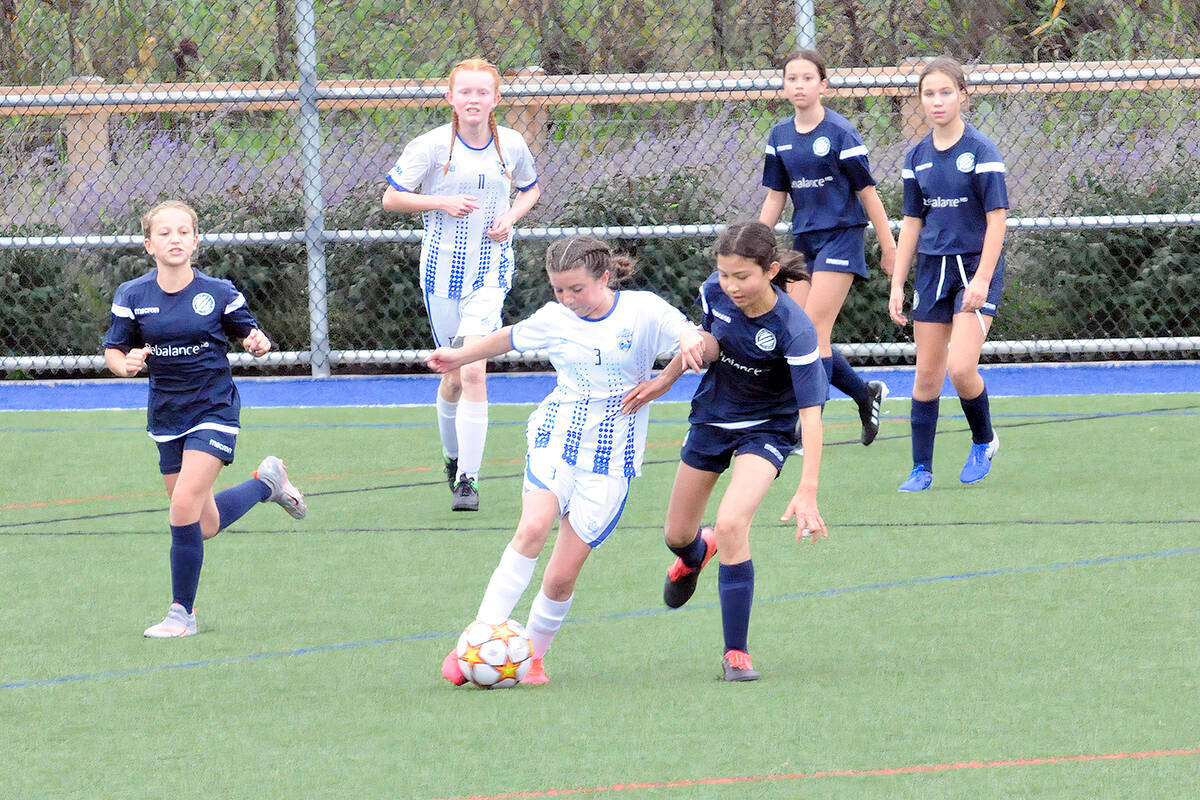 Langley United's Ireland McGill got past a Vancouver Island Wave rival on Sunday, Sept. 19 in the first BC Soccer Premier League games since the return to play was shut down due to Covid 19. (Dan Ferguson/Langley Advance Times)