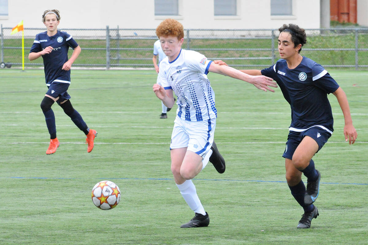 Langley United's Max Sullivan fended off a Vancouver Island Wave opponent on Sunday, Sept. 19 in the first BC Soccer Premier League games since the return to play was shut down due to Covid 19. (Dan Ferguson/Langley Advance Times)