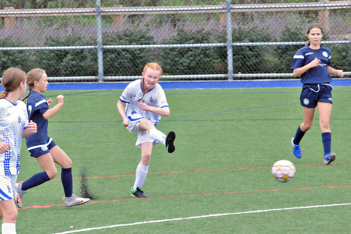 Langley United's Leah Waddell took a shot during a game against Vancouver Island Wave on Sunday, Sept. 19 in the first BC Soccer Premier League games since the return to play was shut down due to Covid 19. Both teams played to a draw. (Dan Ferguson/Langley Advance Times)