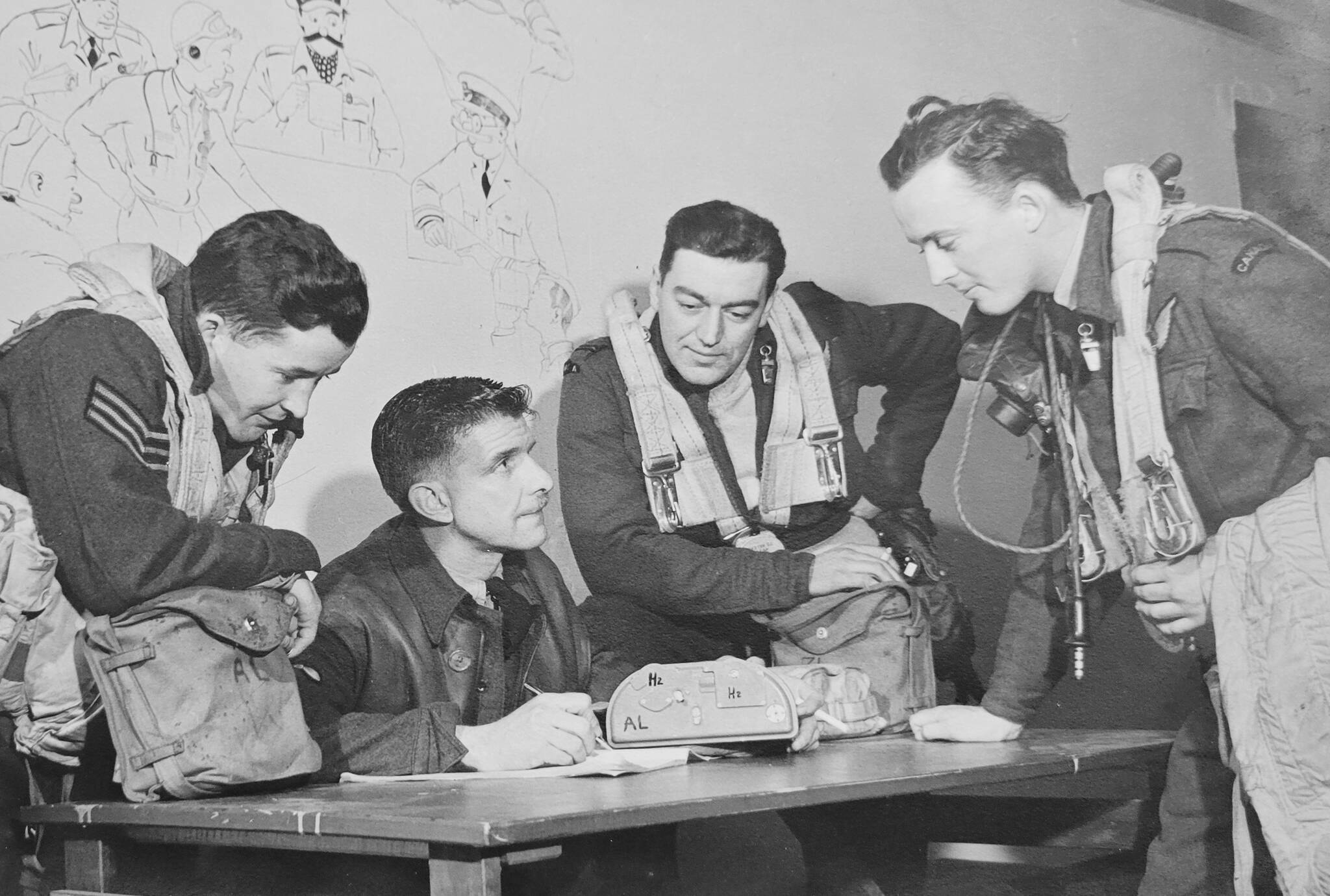 Dick Deck (far right), during a debriefing following a bombing mission over Germany during the Second World War. (Special to Langley Advance Times)