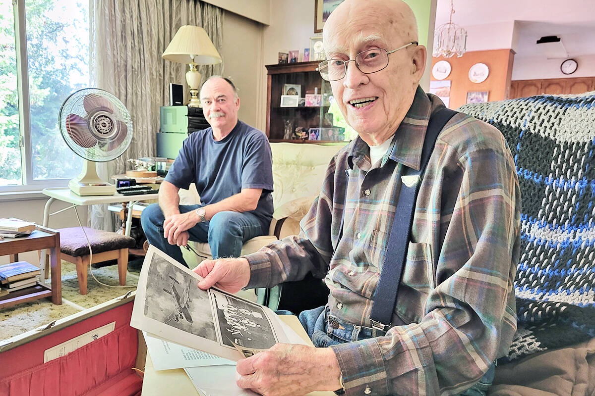 Dick Deck and son Brian go through some of his documents from the Second World War, when he was a bomb aimer in an aircraft that was shot down over Germany. (Dan Ferguson/Langley Advance Times)