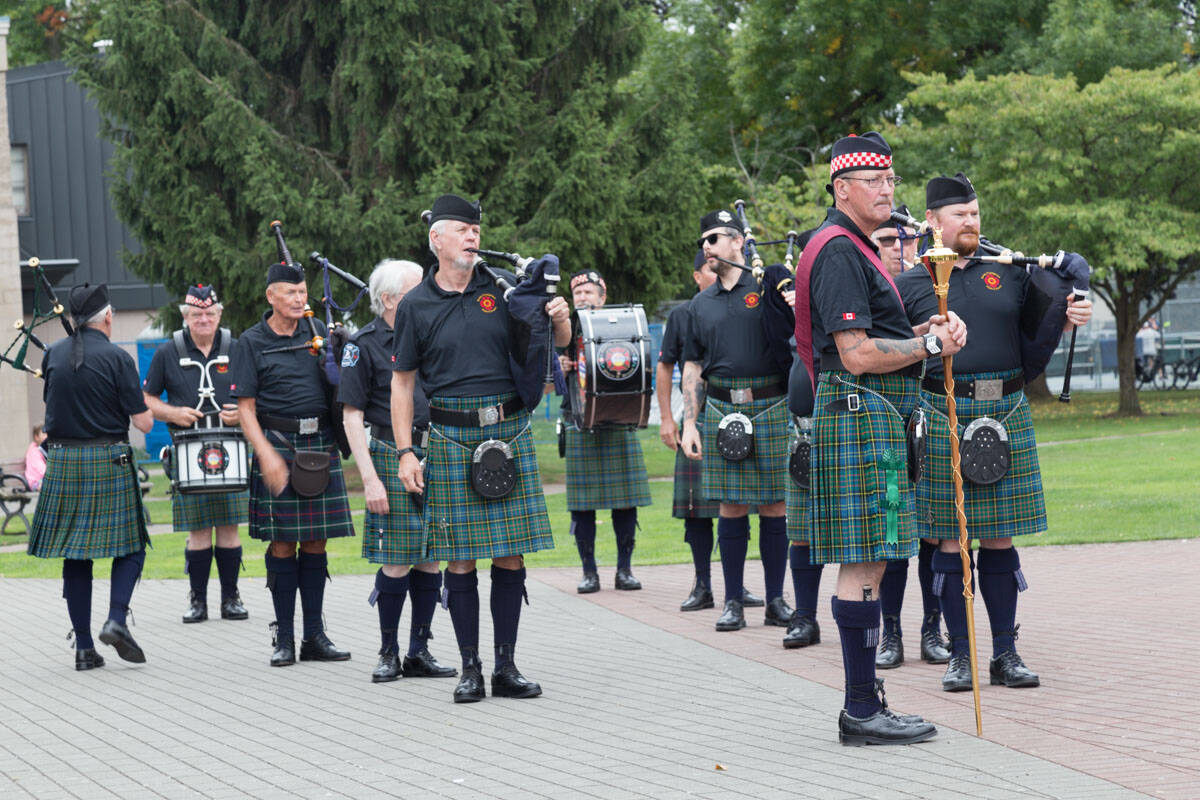 Surrey Firefighters Pipes & Drums band visited Douglas Park in Langley City on Sept. 11, 2021 to commemorate the 20th anniversary of 9/11. (Rosemary Wallace/Special to Langley Advance Times)