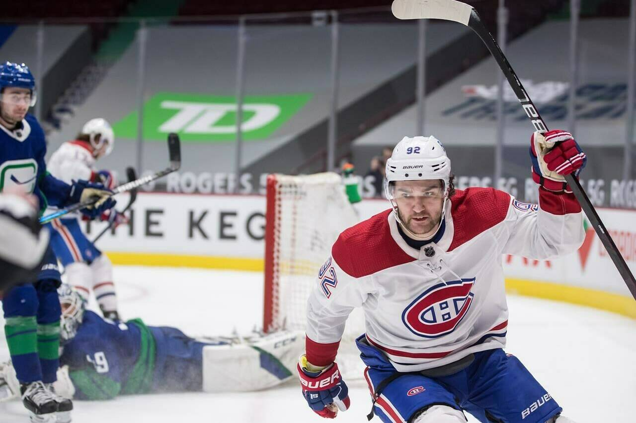 Montreal Canadiens' Jonathan Drouin celebrates his goal against Vancouver Canucks goalie Braden Holtby during the third period of an NHL hockey game in Vancouver on January 23, 2021. THE CANADIAN PRESS/Darryl Dyck