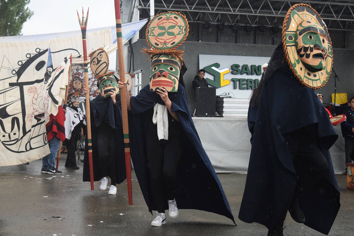 Kwakwaka'wakw dancers brave the rain during a totem pole unveiling ceremony on Port Alberni on Sept. 18, 2021. (ELENA RARDON / ALBERNI VALLEY NEWS)