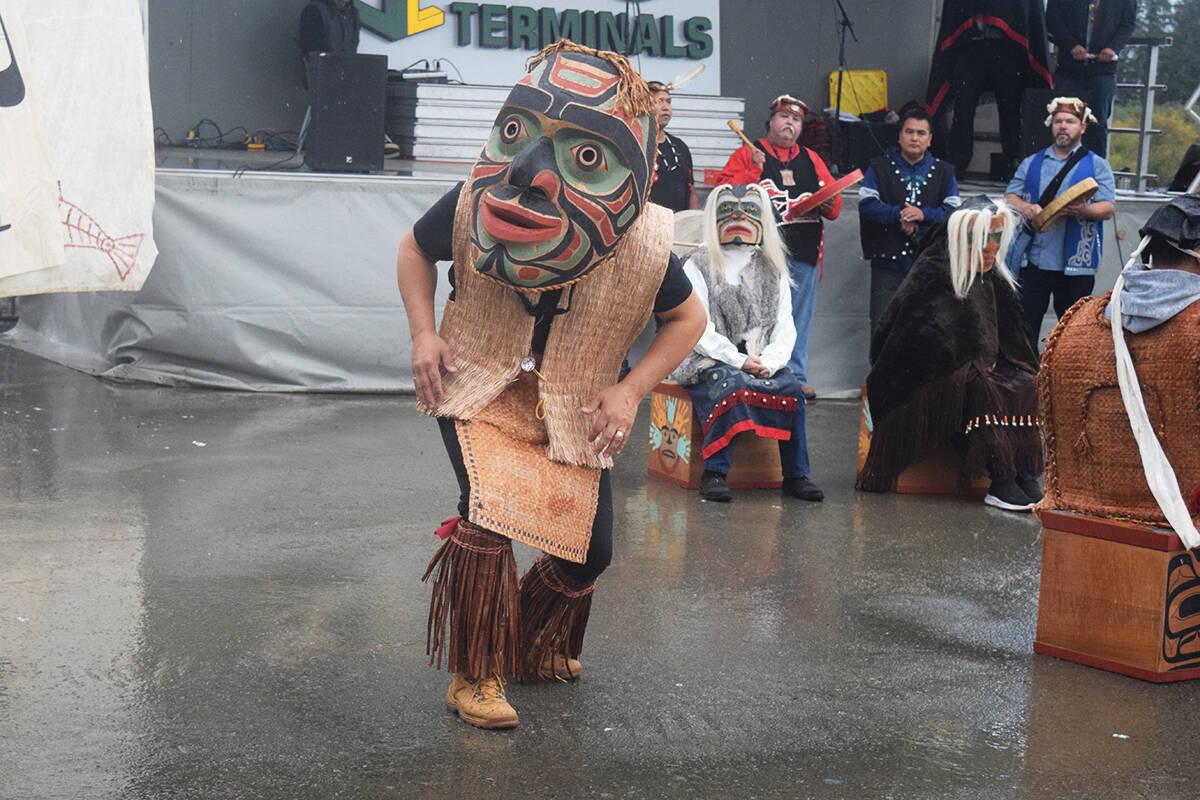 A Kwakwaka'wakw dancer wearing an earthquake mask dances during a totem unveiling ceremony in Port Alberni on Sept. 18, 2021. (ELENA RARDON / ALBERNI VALLEY NEWS)