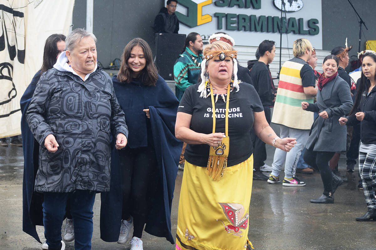 Nuu-chah-nulth and Kwakwaka'wakw dancers dance to the Grease Trail Song during a totem pole unveiling ceremony in Port Alberni on Sept. 18, 2021. (ELENA RARDON / ALBERNI VALLEY NEWS)