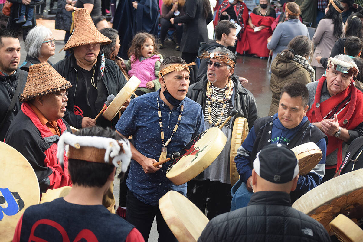 Nuu-chah-nulth and Kwakwaka'wakw drummers sing the Grease Trail Song during a totem pole unveiling ceremony in Port Alberni on Sept. 18, 2021. (ELENA RARDON / ALBERNI VALLEY NEWS)
