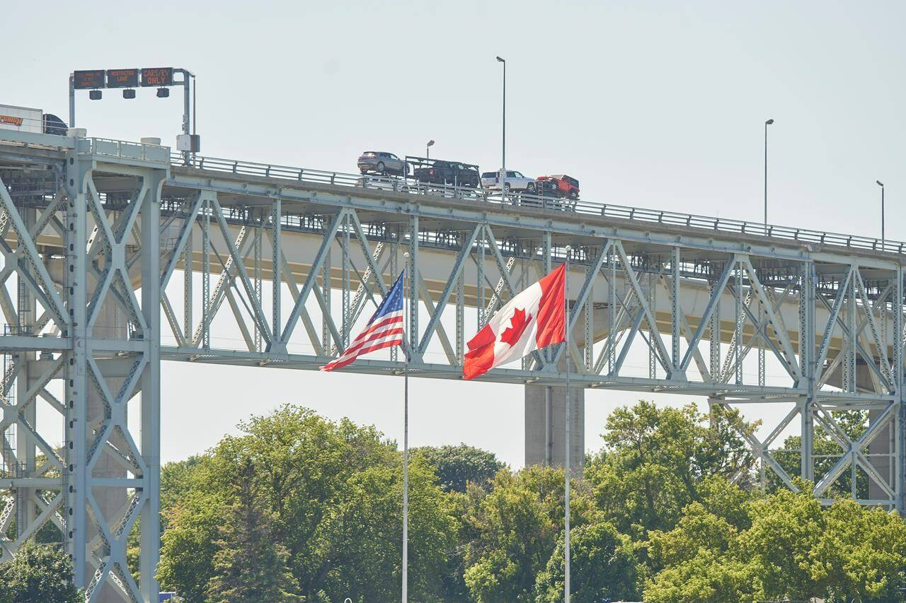 Trucks cross the Bluewater Bridge between Sarnia, Ont., and Port Huron, Mich., on August 15, 2021. THE CANADIAN PRESS/Geoff Robins