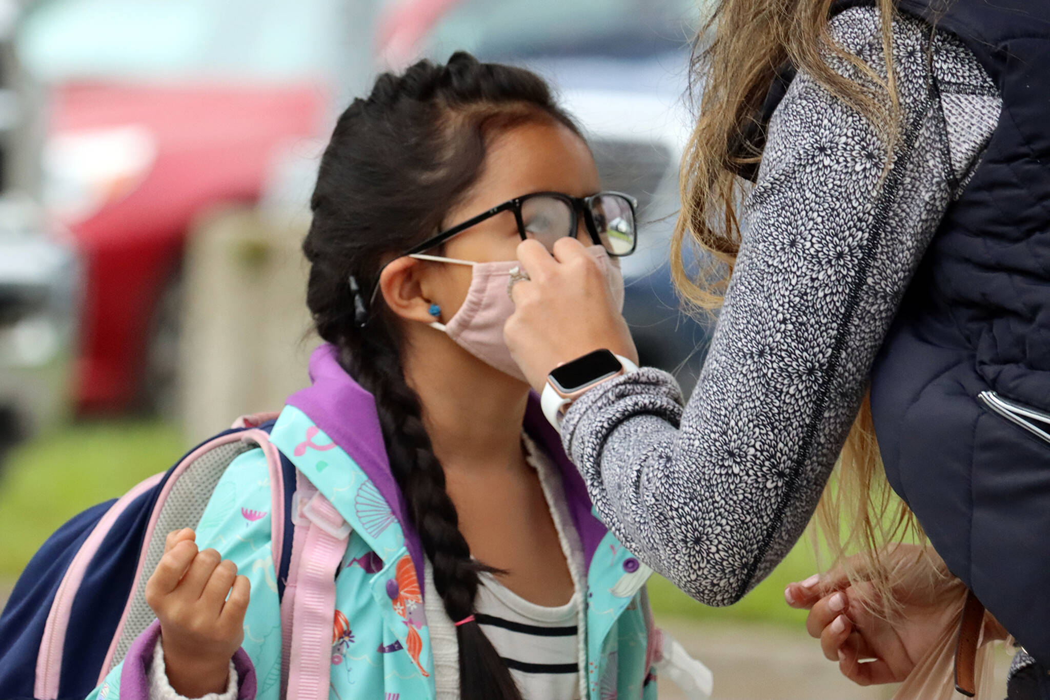 A second-grader has her mask adjusted before heading into school for the day. (Black Press Media file photo)