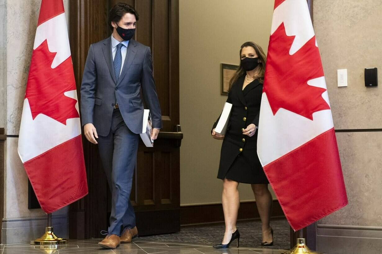 Prime Minister Justin Trudeau, left, arrives with Deputy Prime Minister and Minister of Finance Chrystia Freeland as she prepares to table the federal budget in the House of Commons in Ottawa, on Monday, April 19, 2021. THE CANADIAN PRESS/Justin Tang