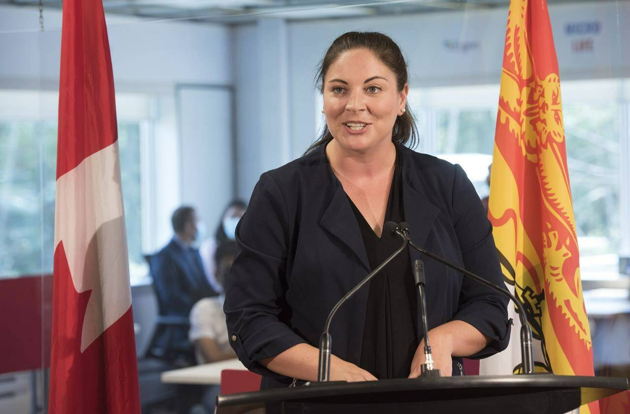Jenica Atwin, Member of Parliament for Fredericton, speaks to the media during a funding announcement in Fredericton, N.B., on July 23, 2021. She was declared re-elected as a Liberal after Elections Canada finished counting special ballots. THE CANADIAN PRESS/Stephen MacGillivray
