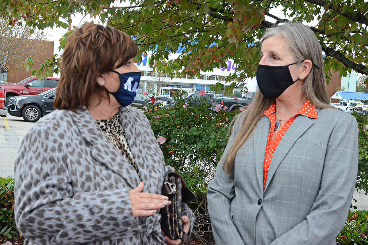Langley City Mayor Val van den Broek talked with SkyTrain extension project director Jennifer MacLean Wednesday at the site of a future station near the Willowbrook Shopping Centre. (Matthew Claxton/Langley Advance Times)
