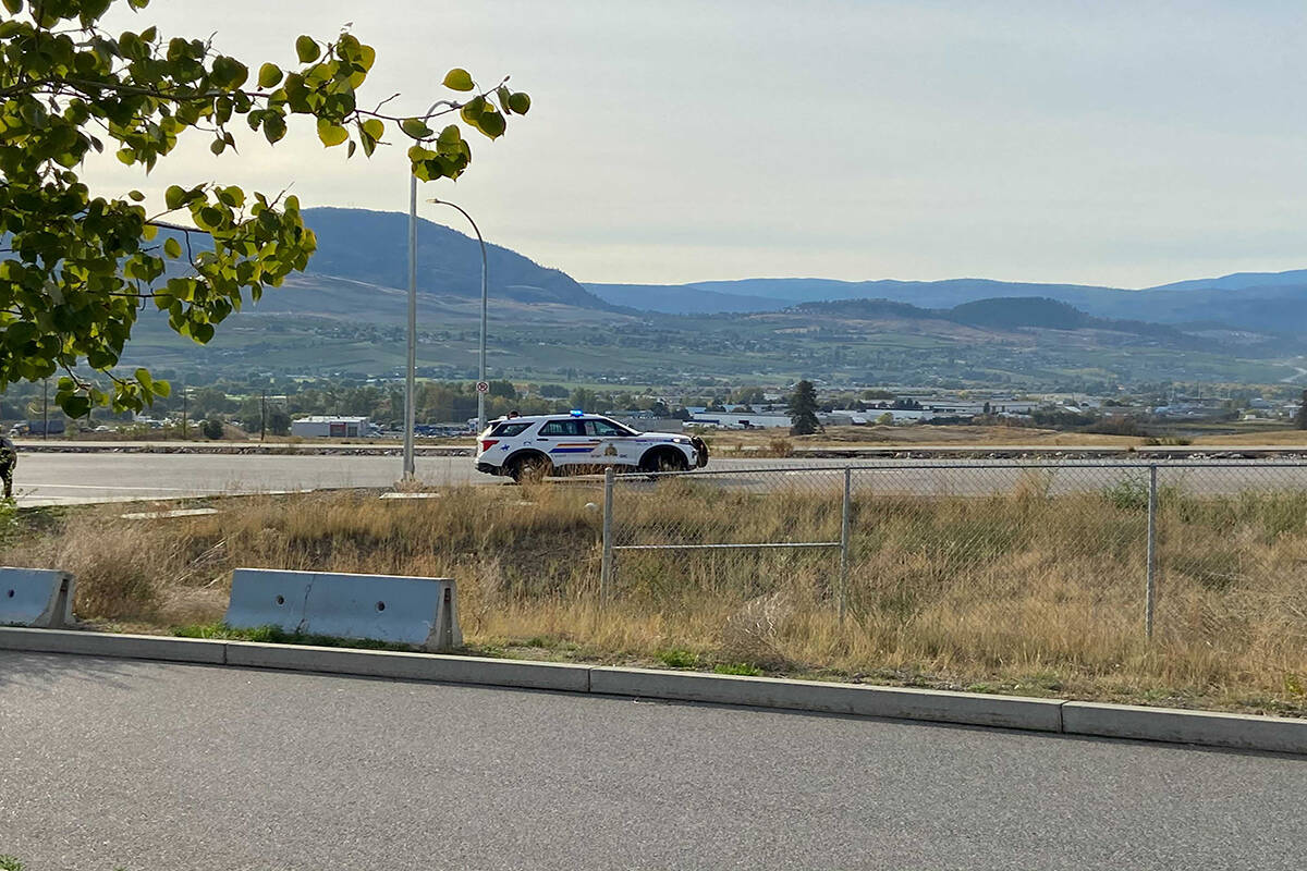 A parked Kelowna RCMP cruiser on Alumni Way on Sept. 23. Mounties have asked the public to avoid the area of Academy Way due to an ongoing police incident. (Twila Amato/Capital News)