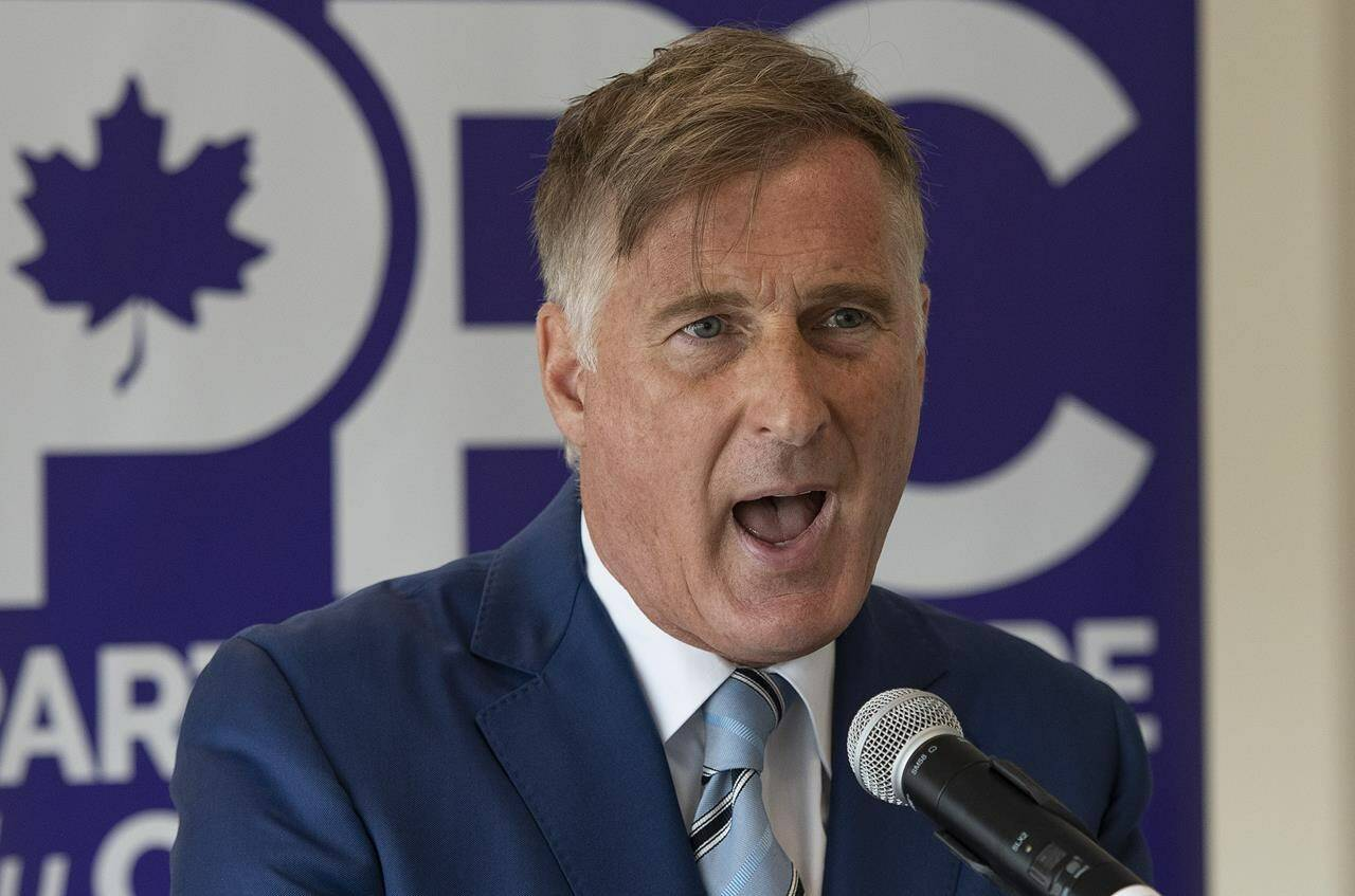People's Party of Canada Leader Maxime Bernier responds to reporters' questions after launching his campaign during a press conference at a hotel in Saint-Georges, Que., Friday, Aug. 20, 2021. THE CANADIAN PRESS/Jacques Boissinot