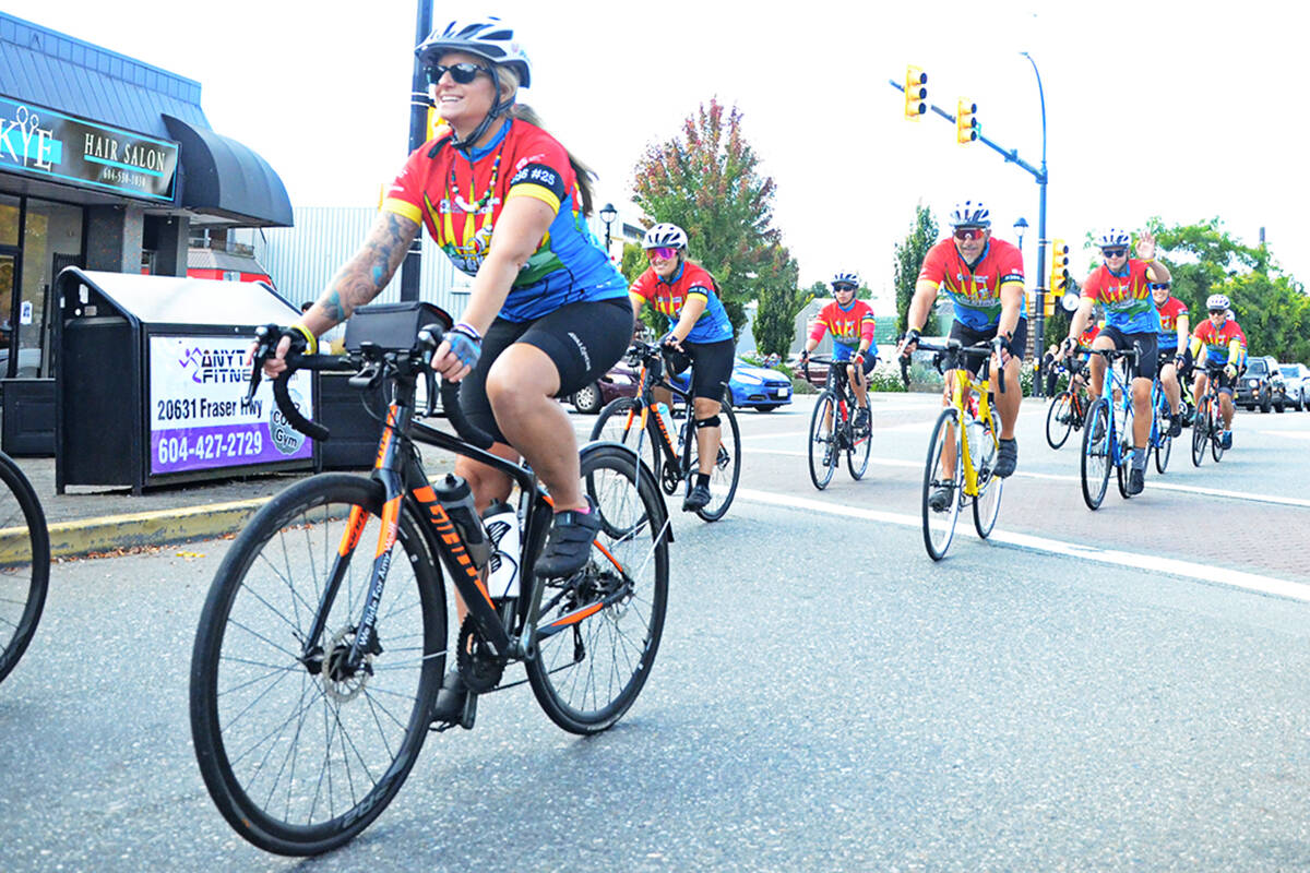 Members of the Cops for Cancer Tour de Valley team rode through downtown Langley City with a police motorcycle escort on Thursday, Sept. 23. (Matthew Claxton/Langley Advance Times)