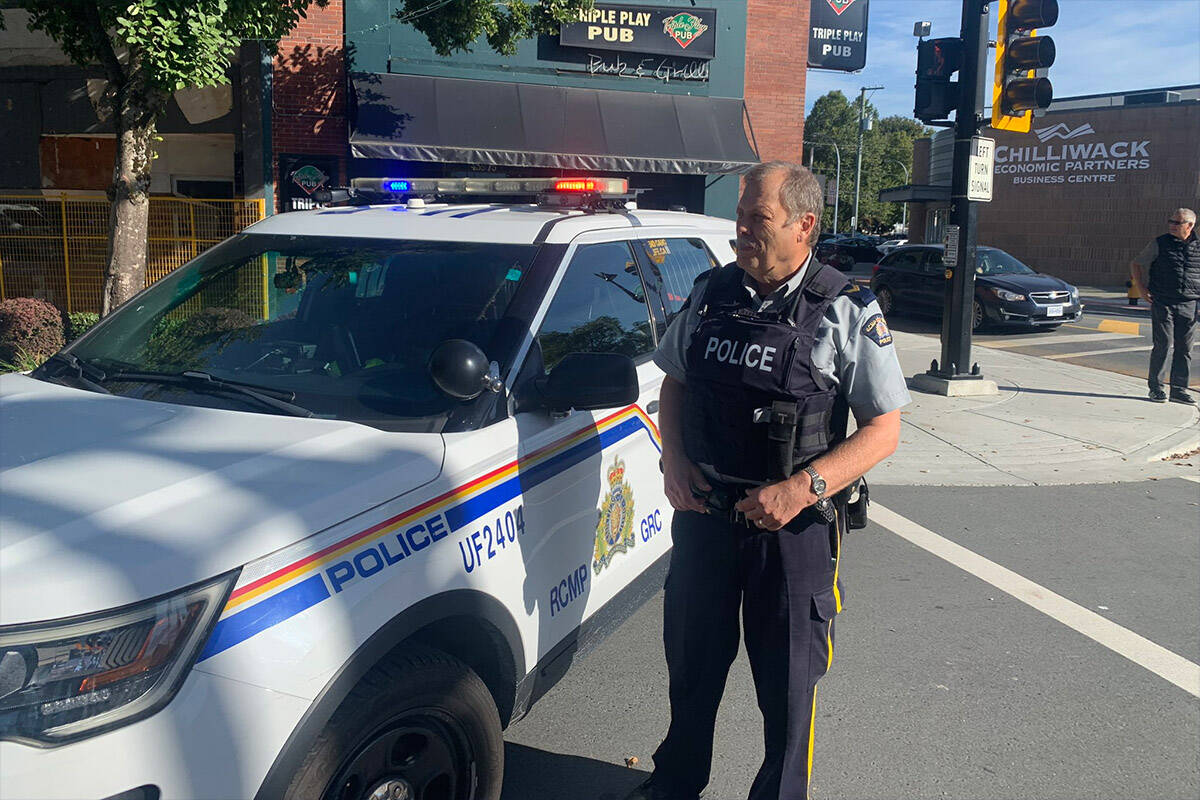 Chilliwack RCMP spokesperson Cpl. Mike Rail on Wellington Avenue at Five Corners at 10 a.m. on Sept. 24, 2021 at the scene of a report of shots fired. (Paul Henderson/ Chilliwack Progress)