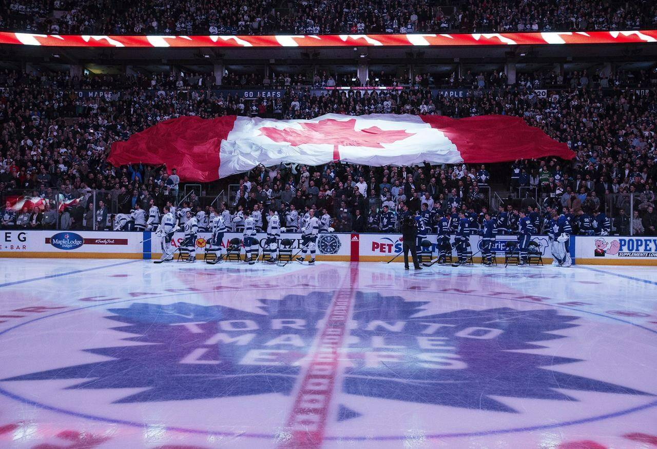 Tampa Bay Lightning and Toronto Maple Leafs players stand for the national anthem prior to NHL hockey action in Toronto on Tuesday, January 2, 2018. THE CANADIAN PRESS/Frank Gunn