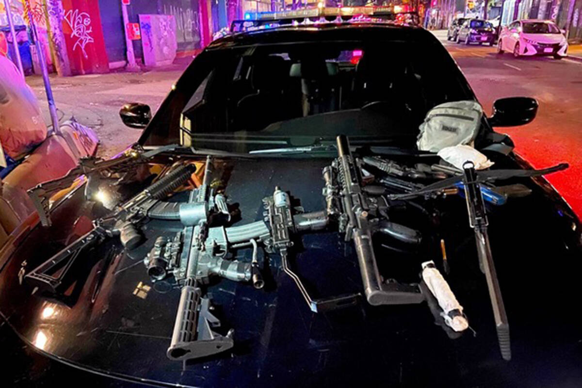 A cache of weapons was recovered by Vancouver Police after a man was shot with a crossbow from a fire escape in the downtown eastside. (VPD photo)
