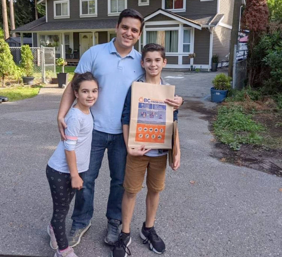 Volunteers dropped off brown paper bags in neighbourhoods around the Lower Mainland for the annual Thanksgiving Food Drive. (Special to Black Press Media)