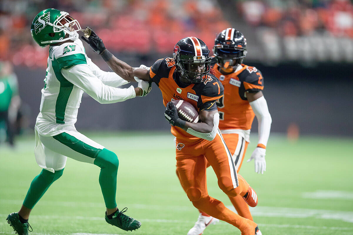B.C. Lions' Lucky Whitehead (7) pushes Saskatchewan Roughriders' Nick Marshall away as he runs with the ball after making a reception during the first half of a CFL football game in Vancouver, on Friday, September 24, 2021. THE CANADIAN PRESS/Darryl Dyck