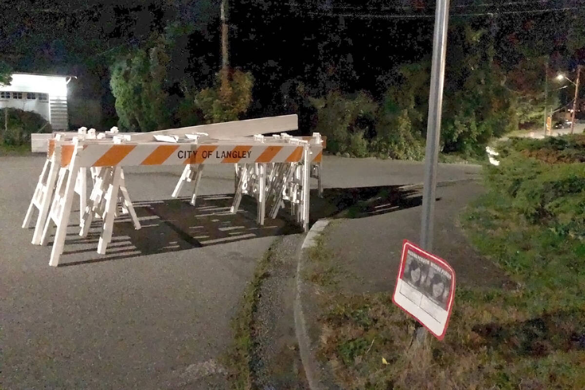 Police removed barricades on Friday, Sept. 24, from the street running past the home of missing Langley City woman Naomi Onotera. (Heather Colpitts/Langley Advance Times)