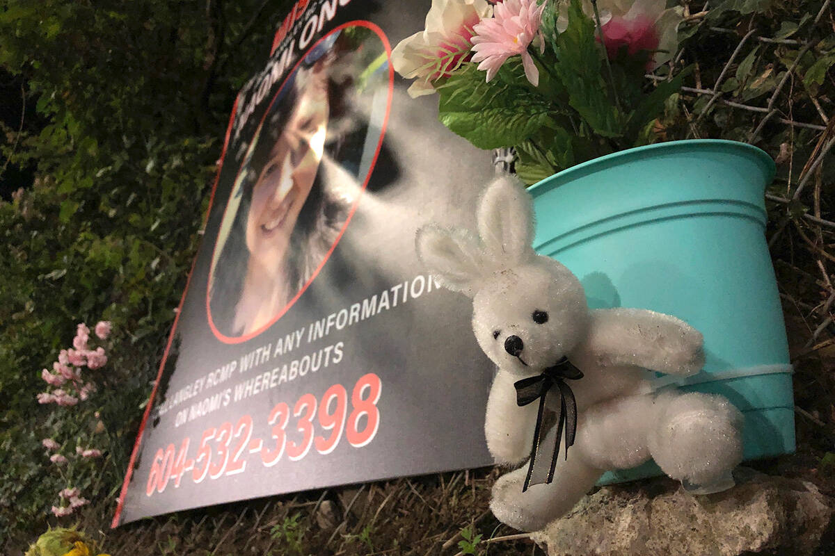 Some people have left flowers, a stuffed rabbit and a painted stone near the home of Naomi Onotera. (Heather Colpitts/Langley Advance Times)