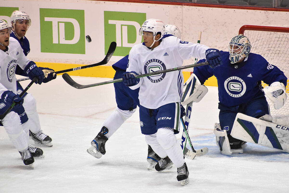 Canucks defenceman Alex Kannok-Leipert tries to control a puck in the air during day three of the club's training camp in Abbotsford. (Ben Lypka/Abbotsford News)