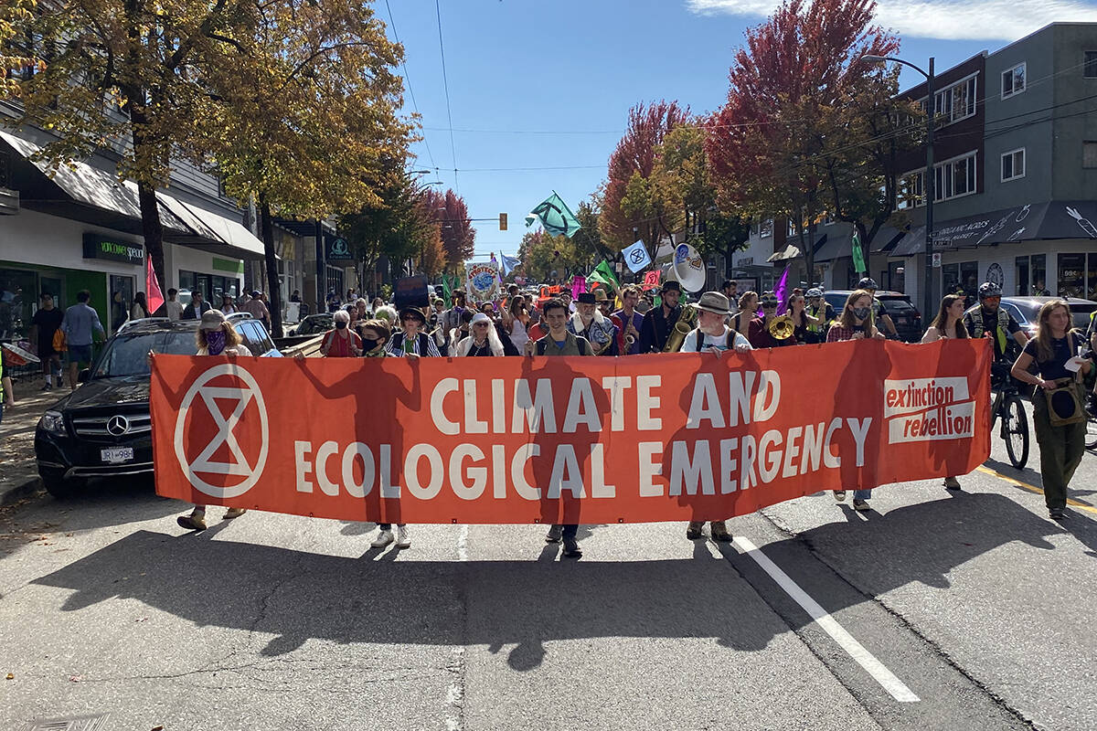 Extinction Rebellion protesters marched down Vancouver's Main Street on Sept. 25. (Cole Schisler photo)