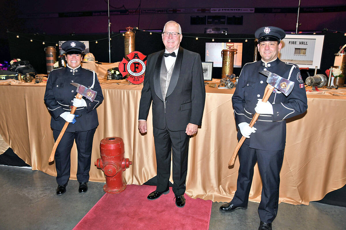 """Mayor Jack Froese (centre) called the unexpected $500,000 contribution by Vesta Properties a """"nice surprise"""" at the third annual Mayor's Charitable Gala fundraiser, held at the Langley Events Centre Fieldhouse Saturday, Sept. 25 event. (Jhim Burwell/Special to Langley Advance Times)"""