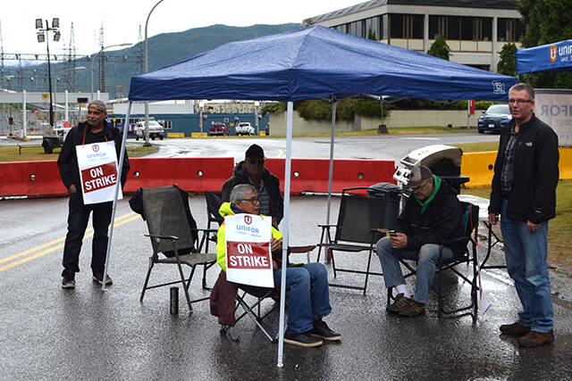 A photo of Unifor Local 2301 members picketing outside of the Rio Tinto smelter in Kitimat BC, in July . (Jacob Lubberts photo)