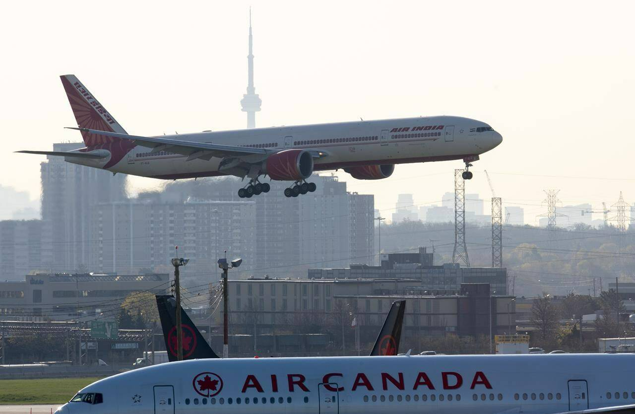 Air India flight 187 from New Delhi lands at Pearson Airport in Toronto on Friday, April 23, 2021. Direct passenger flights from India to Canada resumed Monday as Transport Canada lifted a months-long ban imposed due to high COVID-19 case counts. THE CANADIAN PRESS/Frank Gunn