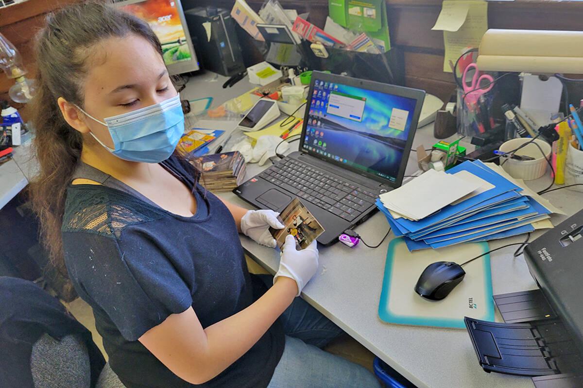 Alder Grove Heritage Society volunteer Iris Okazaki was digitizing photos from the Aldergrove Star photo morgue Saturday, Sept. 25, at the society museum during Community Heritage Day. (Dan Ferguson/Langley Advance Times)