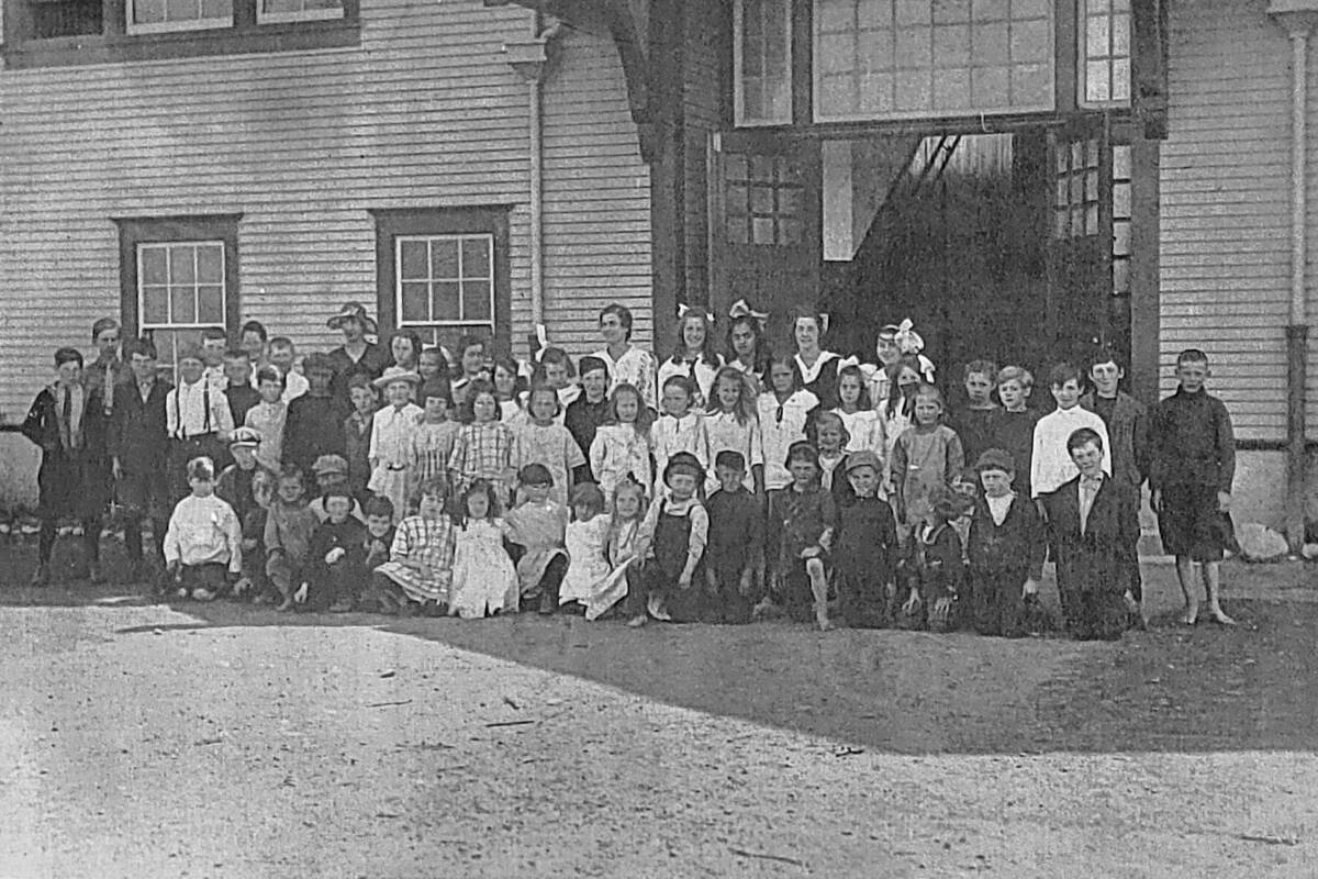 A 1916 photo of senior and junior students at the third Aldergrove school on Fraser Highway was on display Saturday, Sept. 25, at Alder Grove Heritage Society museum to mark Community Heritage Day. (Dan Ferguson/Langley Advance Times)