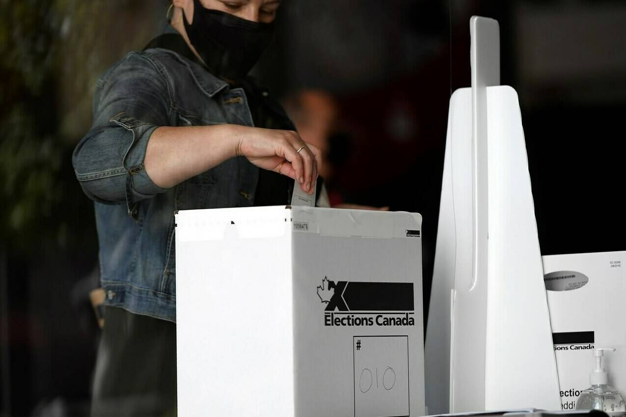 A voter casts their ballot at a polling location on election day during the 44th Canadian general election, on Monday, Sept. 20, 2021. Canadians may not be thrilled with the outcome of last week's federal election but a new poll suggests few are angry that it produced an almost identical result to the 2019 nation-wide vote. THE CANADIAN PRESS/Justin Tang A voter casts their ballot at a polling location on election day during the 44th Canadian general election, on Monday, Sept. 20, 2021. Canadians may not be thrilled with the outcome of last week's federal election but a new poll suggests few are angry that it produced an almost identical result to the 2019 nation-wide vote. THE CANADIAN PRESS/Justin Tang