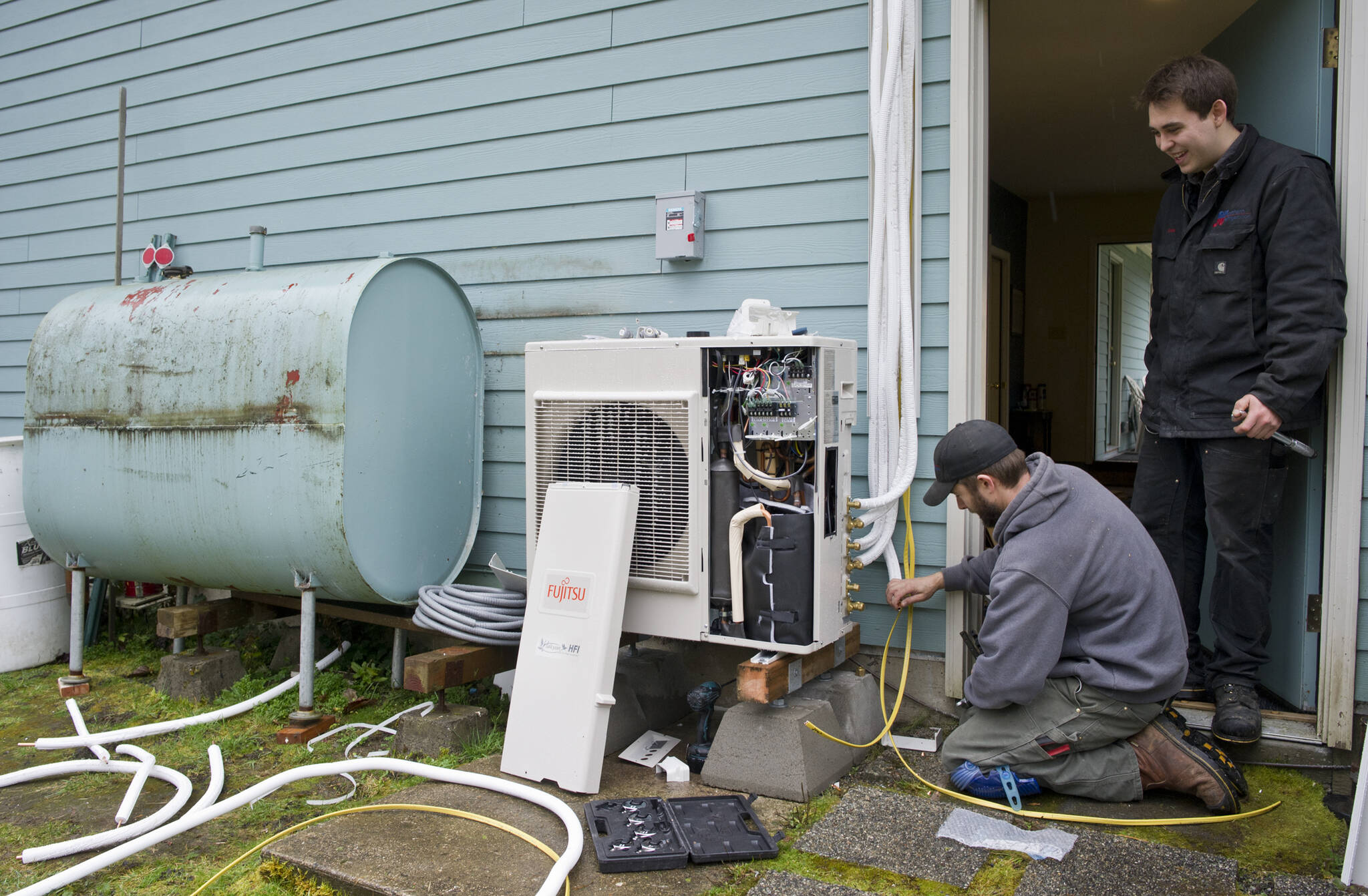 Air-to-air heat pump system installation at an Alaska home using oil for heating. B.C. Hydro is increasing subsidies to make the switch from oil and natural gas to electric heat pumps. (Michael Penn/Juneau Empire)