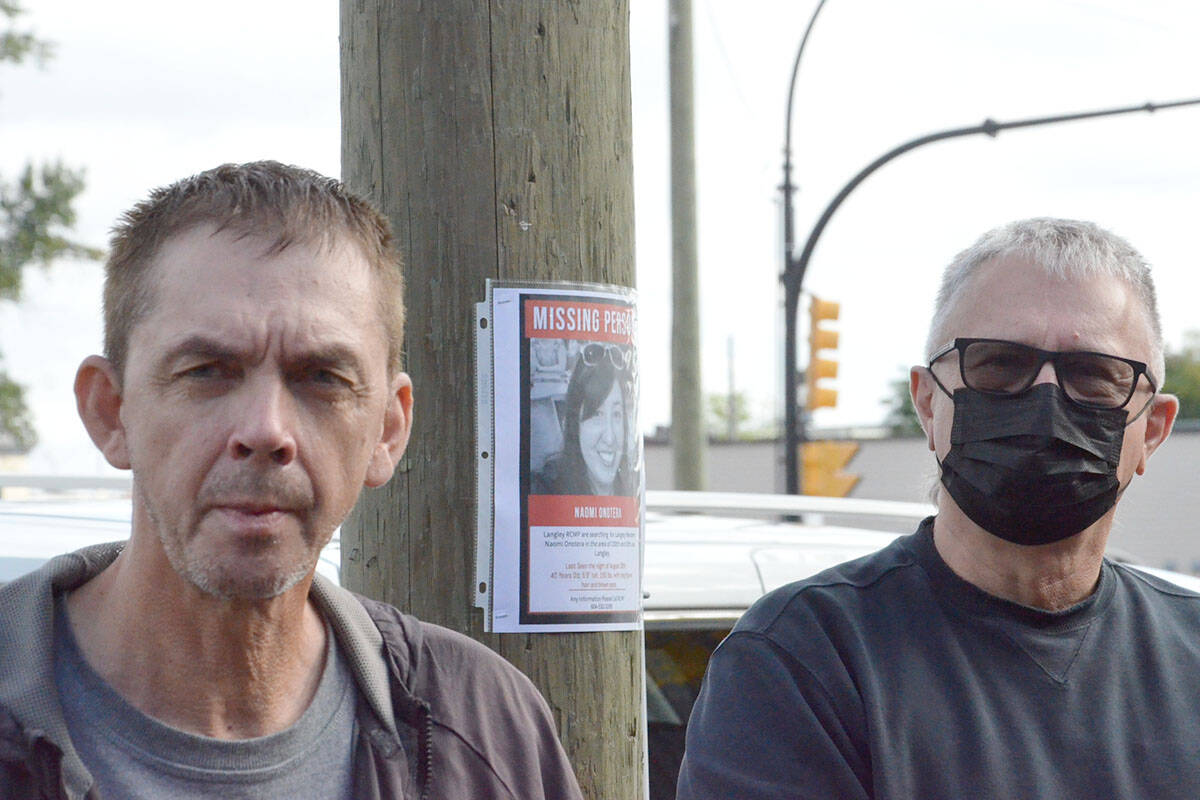 Terrance and Dan Frisk hope putting up handbills and signs about a missing local woman will elicit information from the public that could help with the case. (Heather Colpitts/Langley Advance Times)