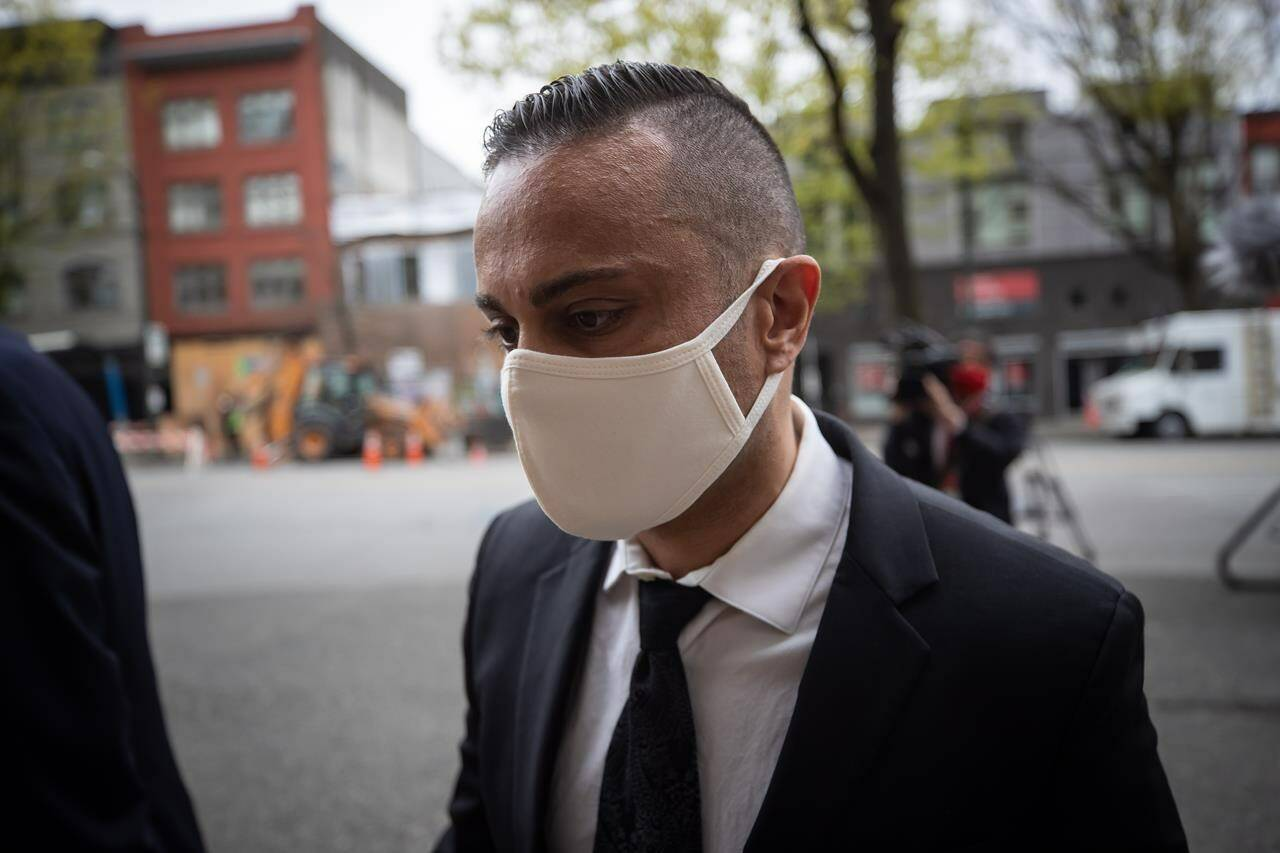 Mohammad Movassaghi arrives at provincial court in Vancouver, on Wednesday, April 28, 2021. THE CANADIAN PRESS/Darryl Dyck