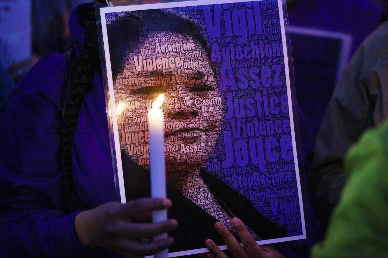 A picture of Joyce Echaquan is seen during a vigil in front of the hospital where she died in Joliette, Que. on Tuesday, September 29, 2020. THE CANADIAN PRESS/Paul Chiasson