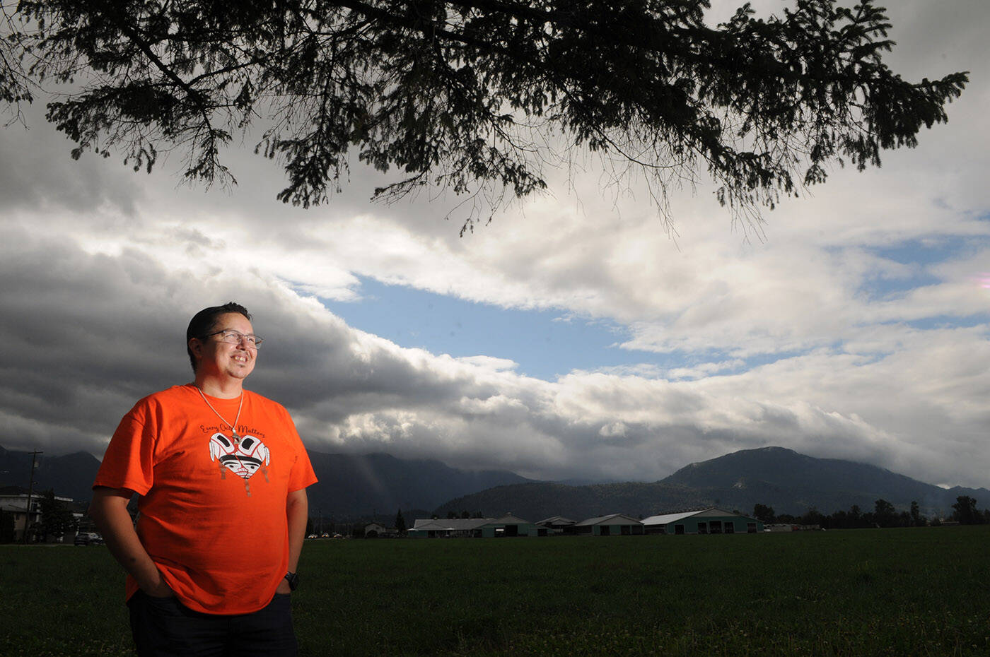 Shawn E. Baginski has been selling orange shirts he designed with all proceeds going to survivors of residential schools. He is pictured here in Chilliwack on Sept. 28, 2021. (Jenna Hauck/ Chilliwack Progress)