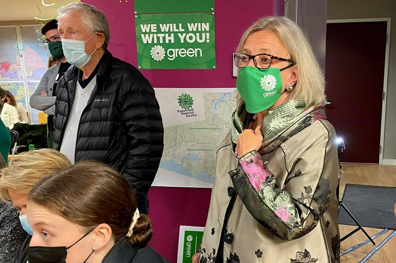 Elizabeth May, right, Green candidate for Saanich-Gulf Islands, watches federal election results roll in during a gathering in Victoria, Monday, Sept. 20, 2021. THE CANADIAN PRESS/Dirk Meissner